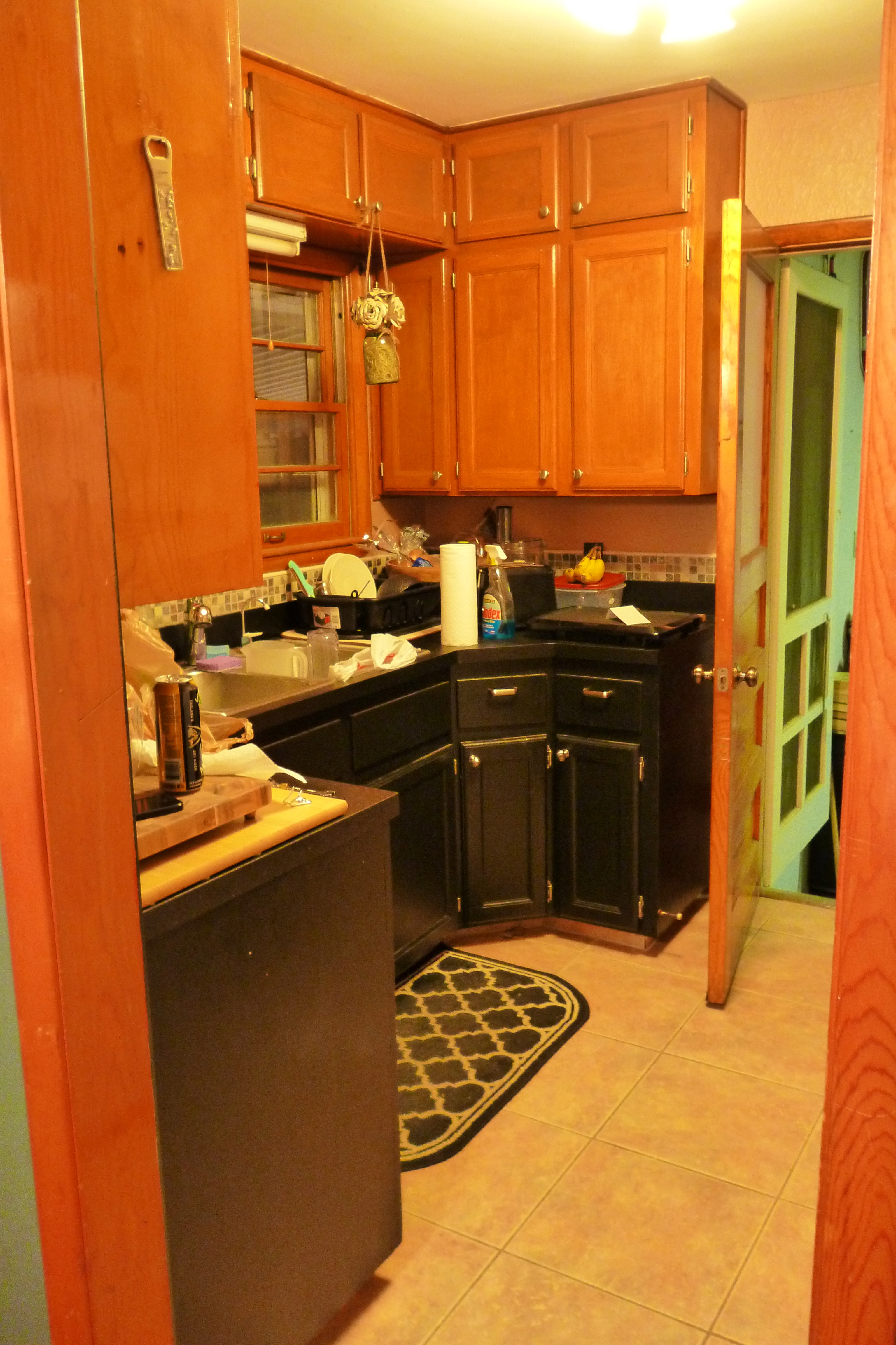 cabinets are black, the top cabinets are brown, the walls? mauve